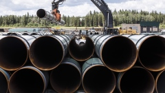 Pipe for the Trans Mountain pipeline is unloaded in Edson, Alta., June 18, 2019.