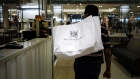 A customer holds a shopping bag inside the Hudson's Bay Co. flagship store in Toronto, Ontario, Canada, on Monday, Aug. 19, 2019. Canadian private equity firm Catalyst Capital Group Inc. bought a 10% stake in Hudson's Bay through a previously announced tender offer as part of its efforts to block a proposed takeover by the retailer's chairman.