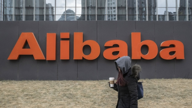 Alibaba Group Holdings Ltd. signage is displayed outside the company's offices in Beijing, China, on Wednesday, Jan. 30, 2019. Alibaba, China's dominant e-commerce company, will offer clues to the health of the nation's middle-class, and how it's navigating the slowdown, when it unveils earnings Jan. 30.