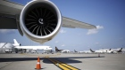 A Rolls Royce Holdings Plc jet engine sits beneath the wing of an Airbus SE A380 passenger jet, operated by Emirates Airline, on static display on the first day of the 16th Dubai Air Show at Dubai World Central (DWC) in Dubai, United Arab Emirates, on Sunday, Nov. 17, 2019. The Dubai Air Show is the biggest aerospace event in the Middle East, Asia and Africa and runs Nov. 17 - 21.