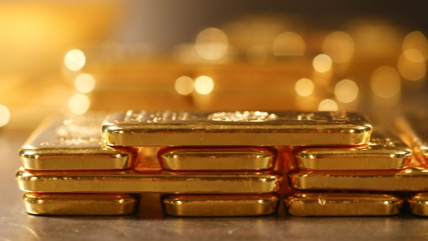 One kilogram fine gold bars sit stacked in the precious metals vault at Pro Aurum KG in Munich, Germany, on Wednesday, July 10, 2019. Gold rose for a third day after the Federal Reserve indicated that it's preparing to cut interest rates for the first time in a decade as the global economy slows.