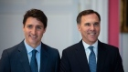 Prime Minister Justin Trudeau stands with Bill Morneau