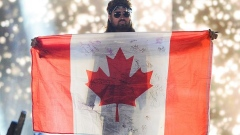 GETTY IMAGES  - BILLY RAY CYRUS HOLDS UP A CANADIAN FLAG
