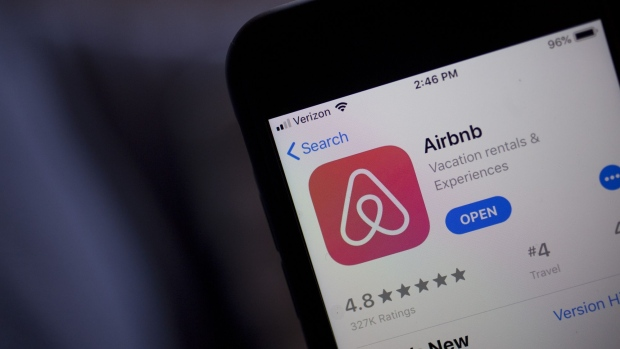 The Airbnb Inc. application is displayed in the App Store on an Apple Inc. iPhone in an arranged photograph taken in Arlington, Virginia, U.S., on Friday, March 8, 2019. Airbnb agreed to buy HotelTonight, its biggest acquisition yet, in a move to increase hotel listings on the site ahead of an eventual initial public offering for the home-sharing startup.