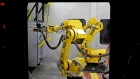 Robots operate inside a manufacturing booth at the General Electric Co. (GE) energy plant in Greenville, South Carolina, U.S., on Tuesday, Jan. 10, 2017. General Electric Co. is scheduled to release earnings figures on January 20.