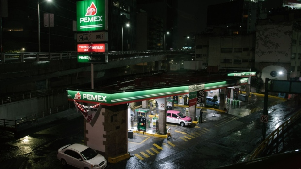 Vehices refuel at a Petroleos Mexicanos (Pemex) gas station at night in Mexico City, Mexico, on Monday, Aug. 6, 2018. Mexico's incoming president named a new chief executive officer for Pemex and promised government investment of 75 billion pesos ($4 billion) in the oil sector, in a bid to revive the state-owned oil company.