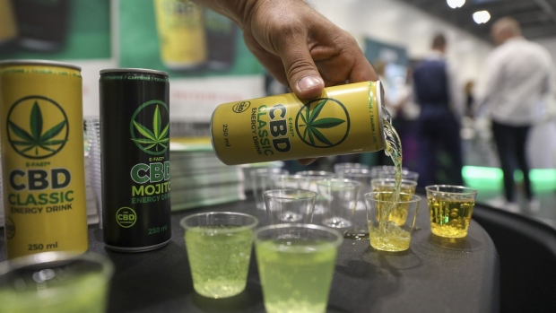 A can of E-fast energy drink is poured at the CBD Hive stand at the Europe CBD Expo at the Excel in London, U.K., on Friday, Jul. 12, 2019. U.K. investors eager for a piece of the cannabis market are being deterred by a broad, catch-all law on proceeds from criminal activities.