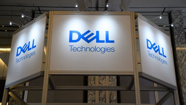 The Dell Technologies Inc. logo is displayed at the company's booth during the SoftBank World 2019 event in Tokyo, Japan, on Thursday, July 18, 2019. The founders of Southeast Asian ride-hailing giant Grab, indoor farming startup Plenty, Indian hotel chain OYO Rooms and payments service Paytm took the stage at an annual SoftBank conference to explain how artificial intelligence helps them stay on top in their respective fields.