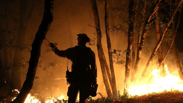CalFire firefighter Brandon Tolp monitors a firing operation while battling the Tubbs Fire on October 12, 2017 near Calistoga, California.