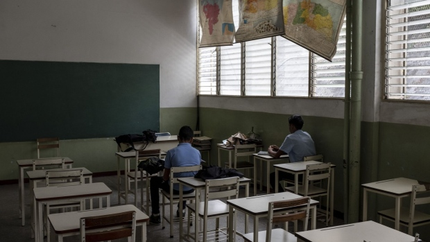 Students ​​take a makeup exam in a classroom during a vacation period. Photographer: Carlos Becerra/Bloomberg