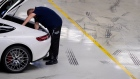 An employee carries out final quality control checks on a newly assembled Mercedes-Benz AG AMG GT high performance luxury automobile at the automaker's plant in Sindelfingen, Germany, on Monday, Dec. 18, 2017. The 2018 Mercedes-Benz GT R sports car sits at the top of the Mercedes AMG GT line, with a 4.0-liter V8 bi-turbo engine that gets 577 horsepower and can hit 60 mph in 3.5 seconds.
