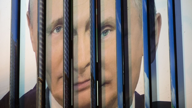 Panels rotate on a trivision election campaign billboard poster featuring incumbent Russian President Vladimir Putin in Moscow, Russia, on Tuesday, Feb. 20, 2018. Voting in the first round of the 2018 Russian presidential election takes place on March 18.