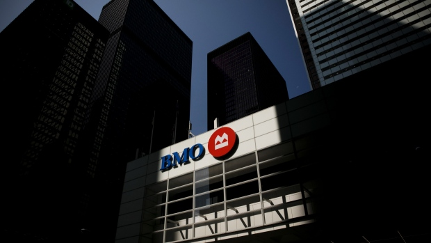 Bank of Montreal (BMO) signage is displayed on a building in the financial district of Toronto, Ontario, Canada, on Thursday, July 25, 2019. Canadian stocks fell as tech heavyweight Shopify Inc. weighed on the benchmark and investors continued to flee pot companies.