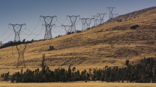 Electrical power lines hang from transmission pylons along a hillside in Mpumalanga, South Africa, on Wednesday, Aug. 7, 2019. Eskom, South Africa's biggest polluter, said emissions of particulate matter that cause chronic respiratory disease are at their highest level in two decades as the state power utility's financial meltdown has seen it skip maintenance and has triggered strikes.