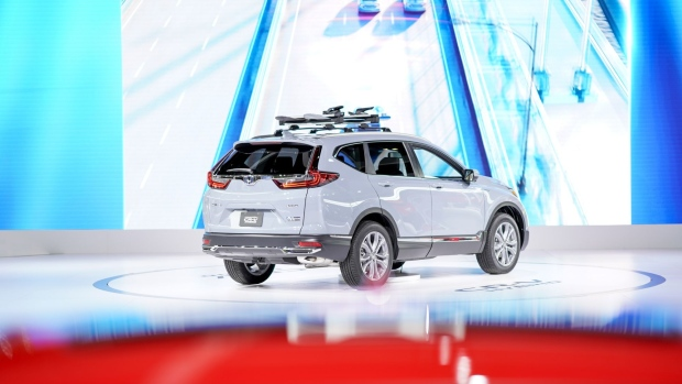 The 2020 Honda Motor Co. CR-V hybrid compact sports utility vehicle (SUV) is displayed at the AutoMobility LA ahead of the Los Angeles Auto Show in Los Angeles, California, U.S., on Thursday, Nov. 21, 2019. Engines are taking a back seat to motors at this years Los Angeles Auto Show as carmakers showcase the latest electric additions to their vehicle lineups.