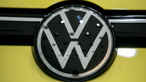 The updated Volkswagen AG (VW) badge sits on a VW Golf 8 hybrid automobile in a showroom at the automaker's headquarters in Wolfsburg, Germany, on Wednesday, Oct. 30, 2019. Volkswagen lowered its outlook for vehicle deliveries this year on a faster-than-expected decline in auto markets around the world amid economic jitters in Europe and an unprecedented slump in China.