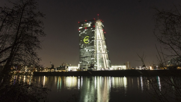 An illuminated euro currency symbol is projected on to the European Central Bank (ECB) headquarters during the Luminale light festival in Frankfurt.