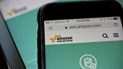 The Amazon.com Inc. Amazon Web Services (AWS) Shield website is displayed on an Apple Inc. iPhone and iPad in Washington, D.C., U.S., on Monday, Dec. 5, 2016. Amazon.com unveiled a new security tool for cloud customers last week, part of a slew of product announcements designed to fend off competition from Microsoft Corp., Alphabet Inc.'s Google and others in the fast-growing cloud computing market.