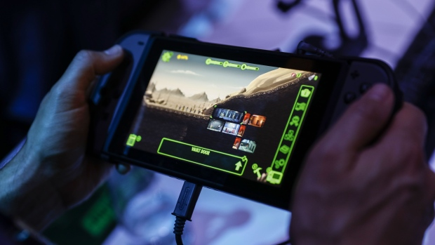 An attendee plays the Bethesda Softworks LLC Fallout: Shelter video game on a Nintendo Co. Switch console during the E3 Electronic Entertainment Expo in Los Angeles, California, U.S., in Los Angeles, California, U.S., on Wednesday, June 13, 2018. For three days, leading-edge companies, groundbreaking new technologies and never-before-seen products are showcased at E3.