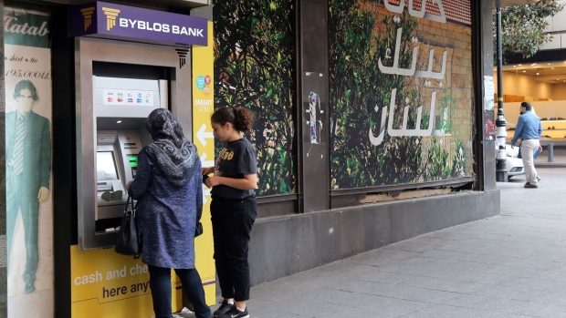 Customers use an ATM in Beirut.
