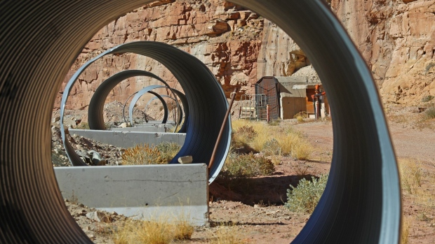 TICABOO, UT - OCTOBER 27: Large pipes frame the entrance of Energy Files Resources, Tony M. Uranium Mine on October 27, 2017 outside Ticaboo, Utah.