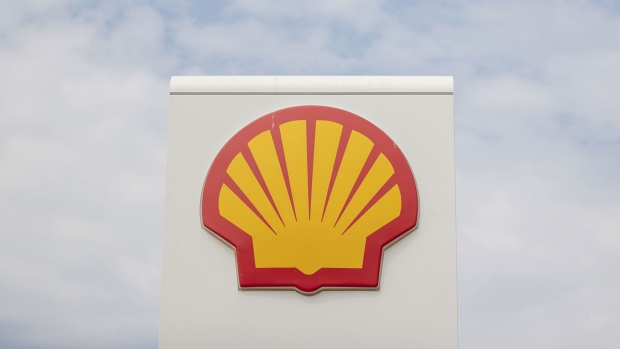 A Shell logo sits on a sign at a gas station, operated by Royal Dutch Shell Plc., in Rotterdam, Netherlands, on Wednesday, July 25, 2018. Shell is scheduled to release earnings figures on July 26.