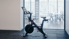 A Peloton Cycle Inc. bicycle stands in the gym area of the Dwight Capital LLC new office space inside 787 11th Avenue in New York, U.S., on Monday, July 30, 2018. The glitzy new offices at 787 11th Avenue in Hell's Kitchen for financial companies are a departure from the building's 1920s roots as a service hub for Packard Motor Car Co. Photographer: Johannes Berg/Bloomberg