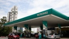 "Vehicles are refueled at a Petroliam Nasional Bhd. (Petronas) gas station in Johor Bahru, Johor, Malaysia, on Thursday, June 20, 2019. Malaysia's Prime Minister Mahathir Mohamad said he underestimated the challenges of governing the country before his shock election victory last year. ""I underestimated because we were on the outside and we didn't get any information on what was happening on the inside,"" Mahathir said."