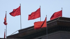 Flags fly atop the Great Hall of the People in Beijing, China, on Wednesday, March 6, 2019. Ongoing trade tensions with the U.S. and slowing growth have taken a toll on China's economy. Those issues are dominating the National People's Congress, an annual gathering of the country's most powerful officials that continued Wednesday in Beijing.