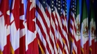 Canadian, American and Mexican flags stand on stage ahead of the first round of North American Free Trade Agreement (NAFTA) renegotiations in Washington, D.C., U.S., on Wednesday, Aug. 16, 2017. Canada and Mexico largely want to defend the advantages they have enjoyed under the two-decade-old Nafta deal, keep it free of tariffs and broaden it to new industries. President Donald Trump has called Nafta the worst trade pact in history and promised to fix it through negotiations or withdraw.