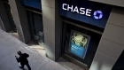 A pedestrian walks past a JPMorgan Chase & Co. bank branch in Chicago, Illinois. Bloomberg