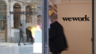 The WeWork logo sits on the exterior of a glass door at the co-working office space, operated by the parent company We Co., on Eastcheap in London, U.K., on Monday, Oct. 7, 2019. While WeWork has been rapidly expanding in Canada, the New York-based company is facing challenges on multiple fronts with Landlords in London and New York the most exposed to any further deterioration at the co-working firm.