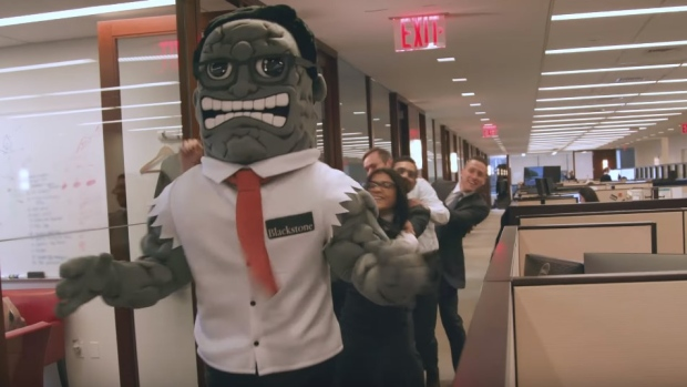 "Still from ""Introducing Blackstone's New Holiday Hire."" YouTube/Blackstone"