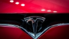 A badge sits on the hood of a Model S electric vehicle displayed inside a Tesla Inc. store in Barcelona, Spain, on Thursday, July 11, 2019.
