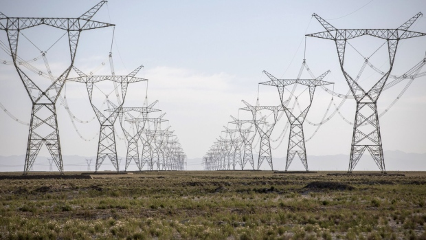 Power lines carrying electricity from the Golmud Solar Park hang from transmission towers on the outskirts of Golmud, Qinghai province, China, on Wednesday, July 25, 2018. China has emerged as the global leader in clean power investment after it spent $127 billion in renewable energy last year as it seeks to ease its reliance on coal and reduce smog in cities, according to a report jointly published by the United Nations and Bloomberg New Energy Finance in April.