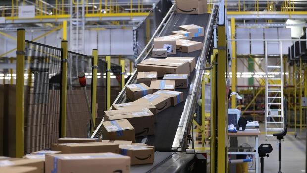 Sealed boxes move along a conveyor into a truck dock ahead of shipping from an amazon com inc fulfilment center during the online retailer s prime day sales promotion day in koblenz germany on monday july 15 2019 amazon is tapping high profile actors athletes and social media sensations like never before to maintain buzz around its prime day summer sale now in its fifth year and battling increasing competition from rivals