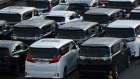 Toyota Motor Corp. vehicles bound for shipment sit at the Nagoya Port in Tokai, Aichi Prefecture, Japan, on Wednesday, June 12, 2019. Toyota brought forward an electrified-vehicle sales target by five years as demand picks up. The company expects to have annual sales of 5.5 million of such vehicles globally in 2025, compared with a previous target of 2030.
