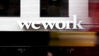 The WeWork logo sits on the company's co-working office space at 165c Weteringschans street in Amsterdam, Netherlands, on Saturday, Oct. 5, 2019. Union Investment, owned by Germany's DZ Bank AG, has expressed interest in ditching WeWork as a potential tenant in Amsterdam's 5 Keizers complex, according to people with knowledge of the matter. Photography: Jasper Juinen/Bloomberg