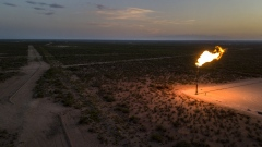 A gas flare is seen at dusk in this aerial photograph taken above a field near Mentone, Texas, U.S., on Saturday, Aug. 31, 2019. Natural gas futures headed for the longest streak of declines in more than seven years as U.S. shale production outruns demand and inflates stockpiles.