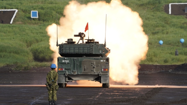 A Japan Ground Self-Defense Force (JGSDF) Type 16 mobile combat vehicle fires ammunition during a live fire exercise by the JGSDF in the Hataoka district of the East Fuji Maneuver Area in Gotemba, Shizuoka Prefecture, Japan, on Thursday, Aug. 22, 2019. The annual exercise by the JGSDF at the foot of Mount Fuji will continue on Aug. 24 and 25.