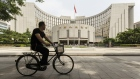 "A man rides a bicycle past the People's Bank of China (PBOC) headquarters in Beijing, China, on Friday, June 7, 2019. China's central bank governor said there's ""tremendous"" room to adjust monetary policy if the trade war deepens, joining counterparts in Europe and the U.S. in displaying readiness to act to support the economy."