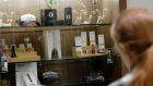 a registered medical marijuana patient looks at products at the Rise cannabis store in Mundelein