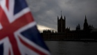 A British Union flag, also known as a Union Jack, flies from a tourist souvenir stall on the bank of the River Thames in view of the Houses of Parliament in London, U.K., on Monday, Oct. 28, 2019.