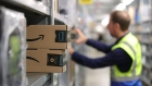 An order picker collects customer delivery orders at an Amazon.com Inc. fulfilment center during the online retailer's Prime Day sales promotion day in Koblenz, Germany, on Monday, July 15, 2019