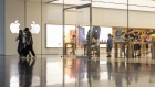 Customers leave an Apple Inc. store in Xiamen, China. Bloomberg/Qilai Shen