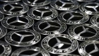 Mercedes-Benz AG trident logo decal badges sit on a tray on the assembly line at the premium automaker's factory, operated by Daimler AG, in Rastatt, Germany, on Monday, Feb. 4, 2019. Daimler announce full year earnings on Feb. 6.