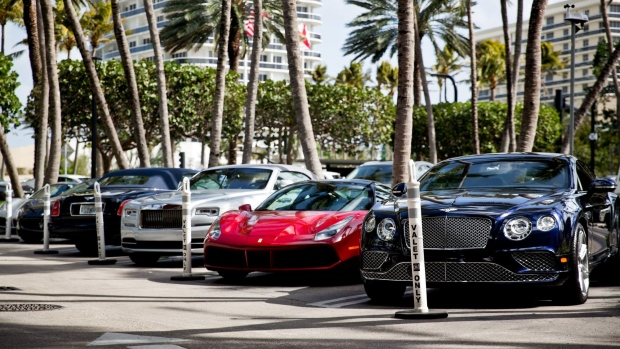 Luxury cars sit parked in the valet area of the Bal Harbour Shops in Miami, Florida, U.S., on Friday, Jan. 26, 2018. While some malls are desperately seeking financial lifelines, Bal Harbour Shops is planning a $400 million expansion. Photographer: Scott McIntyre/Bloomberg