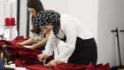 Employees at Canada Goose sew jackets at their new facility in Montreal, Quebec, Canada, on Monday,