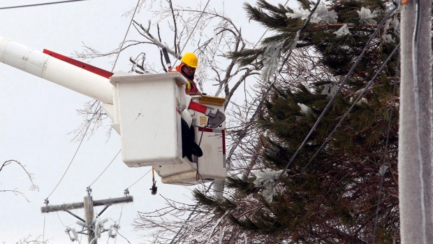 Workers tend to hydro lines near Moncton, N.B., Jan. 26, 2017. The Canadian Press/Ron Ward