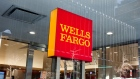 Signage is displayed at a Wells Fargo & Co. bank branch in New York, U.S., on Friday, Jan. 5, 2018. Wells Fargo & Co. is scheduled to release earnings figures on January 12. Photographer: Daniel Tepper/Bloomberg